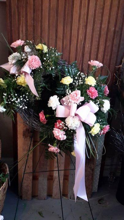 Stunning easle arrangement from Garden Gate Gift and Flower Shop in North Salem, IN