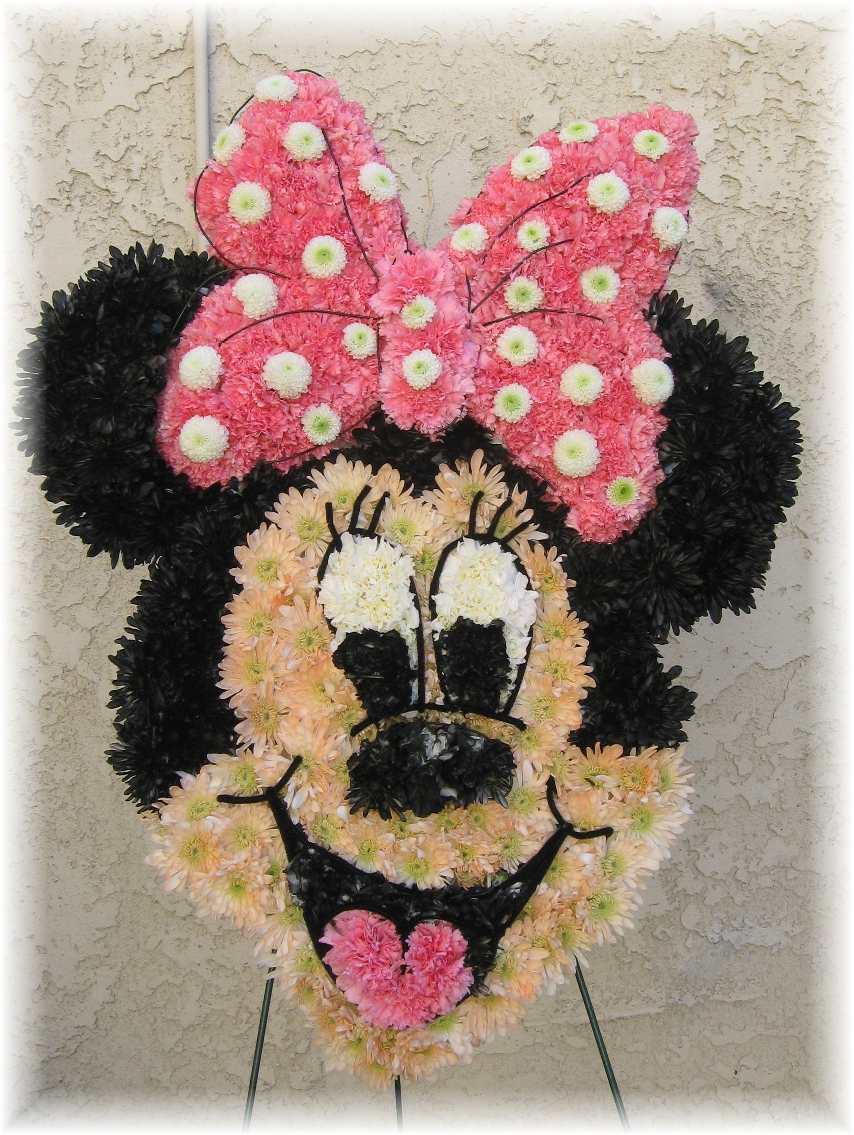 Creative custom funeral flower trends here is a mini mouse made for a little girls funeral izmirmasajfo